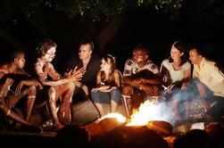 Jantar indígena de Tjapukai com a dança cerimonial Firelit e as histórias de Dreamtime de Palm Cove e de praias do norte