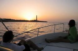 Puesta de sol en barco en Menorca