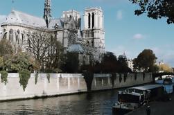 Excursión a pie en grupos pequeños: Desde Notre-Dame hasta los Campos Elíseos