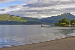 Excursión de un día desde Edimburgo al lago Lomond, Glasgow y el Castillo de Doune con guía que habla español